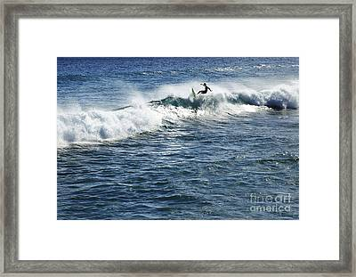 Surfer Riding A Wave Framed Print
