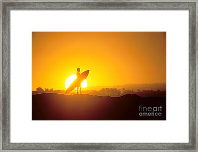 Surfer Silhouetted At Sun Framed Print by Erik Aeder - Printscapes