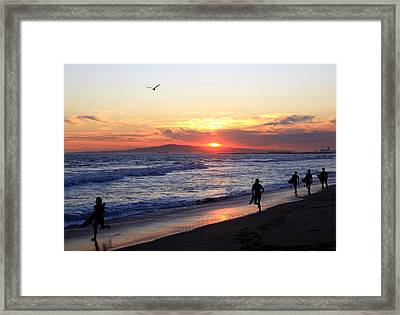 Surfers At Sunset Framed Print by Frank Freni
