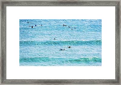 Surfers In The Ocean Framed Print by Jera Sky