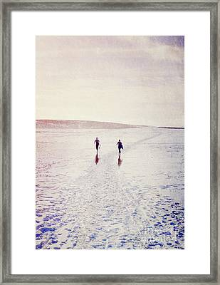 Framed Print featuring the photograph Surfers In The Snow by Lyn Randle