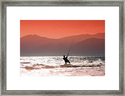 Surfing Into The Sunset Framed Print by Gabriela Insuratelu