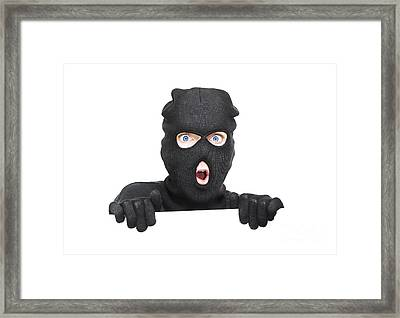 Surprised Robber Holding Blank Security Sign Framed Print by Jorgo Photography - Wall Art Gallery