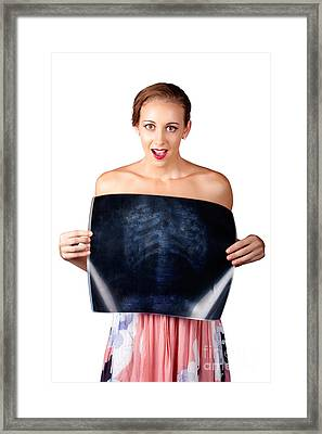 Surprised Woman Holding Chest X-ray Over White Framed Print by Jorgo Photography - Wall Art Gallery