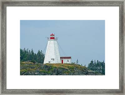 Swallowtail Lighthouse Framed Print by Thomas Marchessault