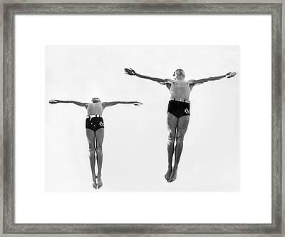 Swan Dive Together Framed Print by Underwood Archives