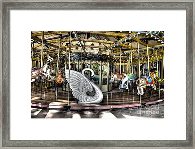 Swan Seat At The Carousel  Framed Print by Michael Garyet