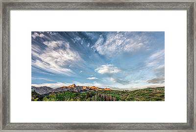 Framed Print featuring the photograph Sweeping Clouds by Jon Glaser