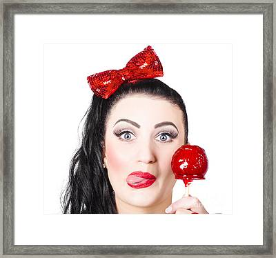 Sweet Pin-up Girl Eating A Candy Toffee Apple Framed Print by Jorgo Photography - Wall Art Gallery