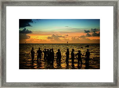 Swimmers Sunrise Framed Print