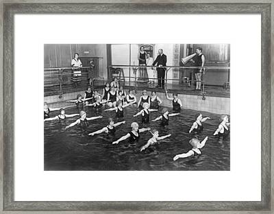 Swimming Lessons In Berlin Framed Print by Underwood Archives