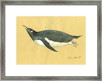 Swimming Penguin Framed Print by Juan  Bosco