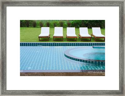 Swimming Pool And Chairs Framed Print by Atiketta Sangasaeng