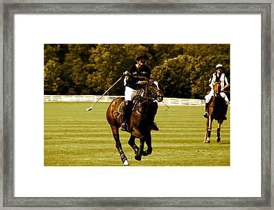 swinging Polo player Framed Print