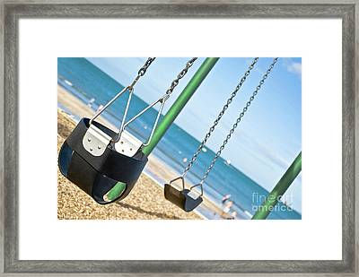 Framed Print featuring the photograph Swings On The Ocean Beach by Yurix Sardinelly