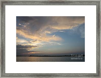 Swirling Clouds Moving In Framed Print