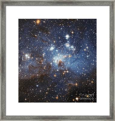 Swirls Of Gas And Dust Reside In This Framed Print