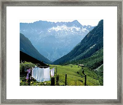 Swiss Laundry Framed Print by Joe Bonita
