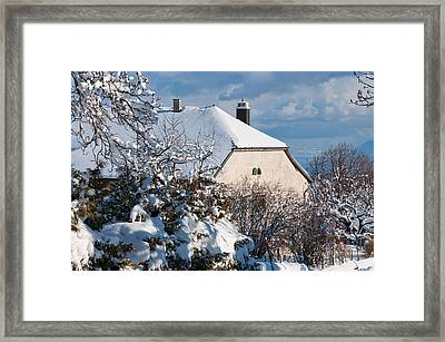 Swiss Village In The Snow Framed Print