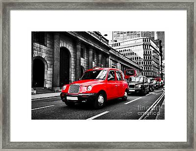 Symbol Of London, The Uk. Taxi Cab Known As Hackney Carriage Framed Print by Michal Bednarek