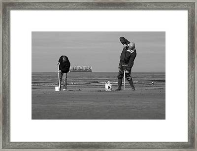 Synchronised Digging Framed Print by Jez C Self