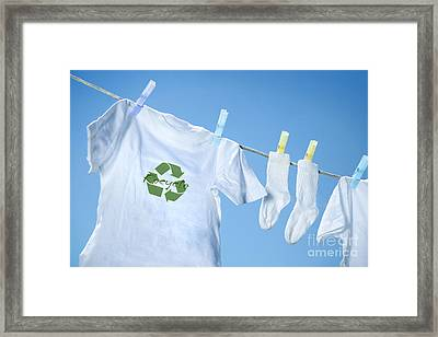 T-shirt With Recycle Logo Drying On Clothesline On A  Summer Day Framed Print by Sandra Cunningham