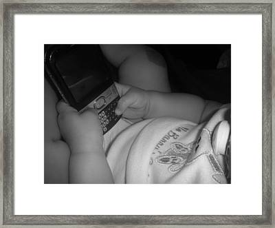 Taking Her First Baby Text..... Framed Print by WaLdEmAr BoRrErO