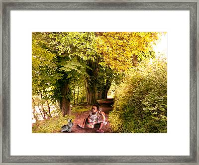 Talking To The Rabbit ... Framed Print by Louloua Asgaraly