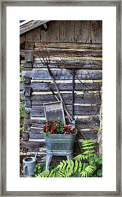Tall Log Cabin And Garden Tools Framed Print by Linda Phelps