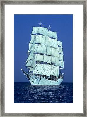 Tall Ship At Sea Framed Print by Kenneth Garrett