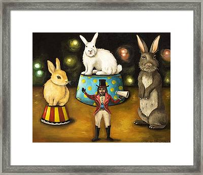 Taming Of The Giant Bunnies Framed Print by Leah Saulnier The Painting Maniac