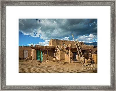 Taos Pueblo Shadows Framed Print