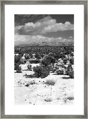 Taos Snowfall Framed Print by Susan Chandler