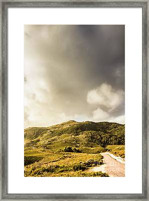 Tasmanian Mountain Against Dramatic Sky Framed Print by Jorgo Photography - Wall Art Gallery