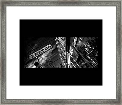Tattoo Parlour On Black Framed Print by Brian Carson