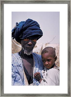 Taureg Father And Son In Senegal Framed Print by Carl Purcell
