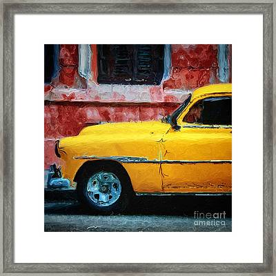 Taxi Against Red Wall Framed Print