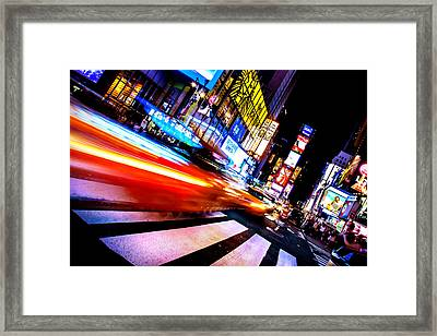 Taxis In Times Square Framed Print