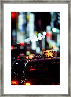 Taxis On The Ginza Framed Print by Brad Rickerby