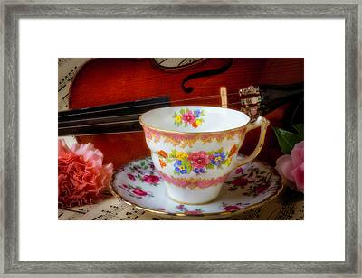 Tea Cup And Violin Framed Print