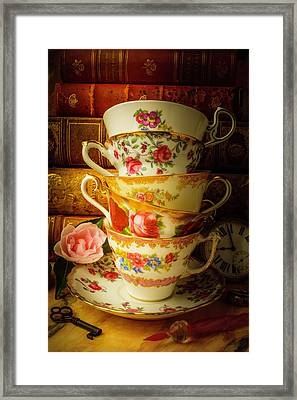 Tea Cups And Antique Books Framed Print