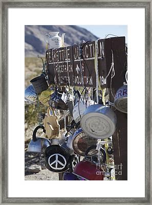 Tea Kettles On Signpost At Teakettle Junction Framed Print