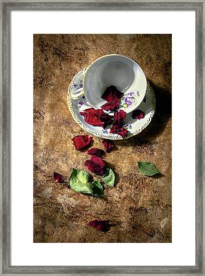 Teacup And Red Rose Petals Framed Print