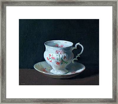 Teacup And Saucer On Dark Background Framed Print
