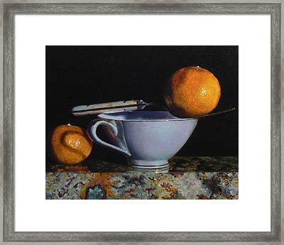 Teacup, Fork, And Two Oranges On Granite Framed Print by Jeffrey Hayes