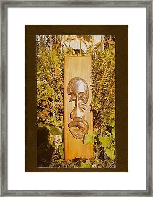 Teak Man Mask Framed Print
