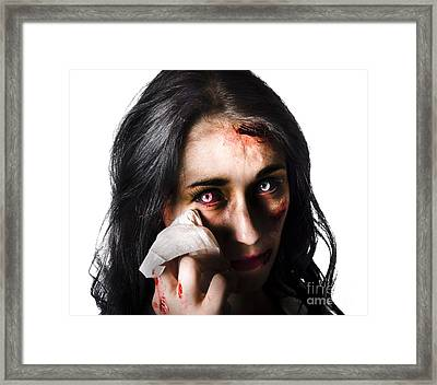 Tearful Woman With Injuries Framed Print