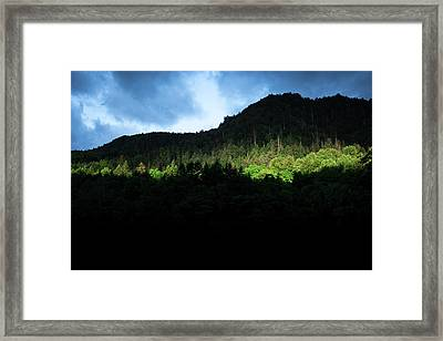 Tearing The Clouds Apart Framed Print by Masa Onikata