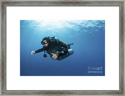 Technical Diver With Equipment Swimming Framed Print by Karen Doody