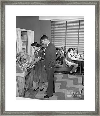 Teen Couple Playing Jukebox, C. 1950s Framed Print by H. Armstrong Roberts/ClassicStock